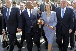Speaker Nancy Pelosi  of California holding the gavel used to pass Medicare Reform, laughs as she walks across the street and into the U.S. Capitol as the House prepares to vote on health care reform in the U.S. Capitol in Washington, Sunday, March 21, 2010. Walking with Speaker Pelosi are from left, Rep. Steny Hoyer, D-Md., Rep. John Lewis, D-Ga., and Rep. John Larson, D-Conn. (AP Photo/Charles Dharapak)