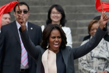 First Lady Michelle Obama with her daughters Malia Obama and Sasha Obama, mother Marian Robinson visit Museum of Terracotta Warriors during a visit to the historic excavation site on March 24, 2014 in Xi'an, China.  Michelle Obama's one-week-long visit in China will be focused on educational and cultural exchanges.